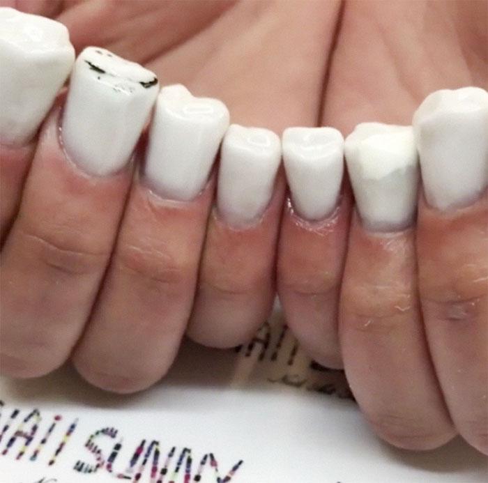 Kwikku, Nail arts bentuk gigi ini juga dilengkapi dengan  molar yang menyerupai milik manusia